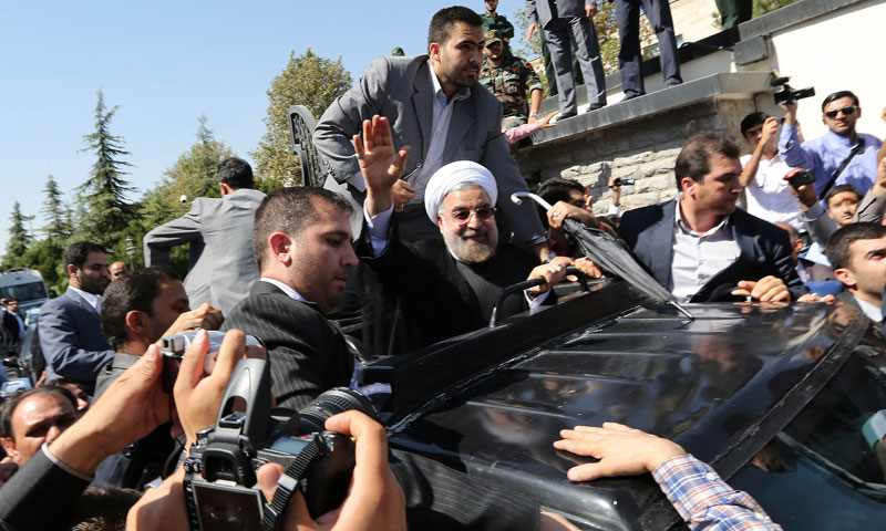 Shoe thrown as Rouhani returns after historic Obama call