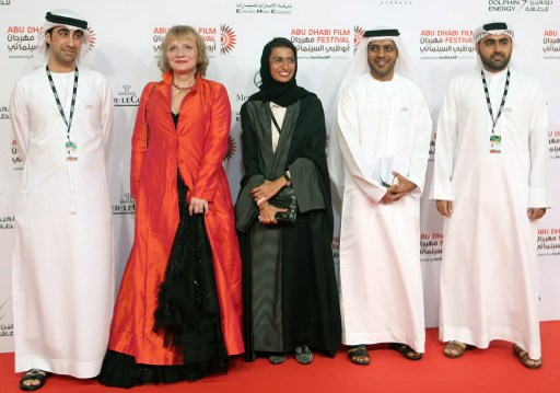 Director of the Abu Dhabi Film Festival (ADFF) Ali al-Jabri (2nf from R), festival's director of programming Teresa Cavina (2nd from L) and unidentified guests arrive to attend the opening ceremony of the Abu Dhabi Film Festival on October 24, 2013 at the Emirates Palace Hotel in Abu Dhabi. AFP PHOTO / STR