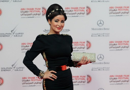 Saudi actress Marwa Mohamed poses as she arrives to attend the opening ceremony of the Abu Dhabi Film Festival (ADFF)on October 24, 2013 at the Emirates Palace Hotel in Abu Dhabi. AFP PHOTO STR