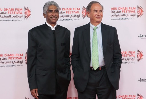 Indian American film producer Ashok Amritaj (L) and CEO of Image Nation Michael Garin arrive to attend the opening ceremony of the Abu Dhabi Film Festival (ADFF)on October 24, 2013 at the Emirates Palace Hotel in Abu Dhabi. AFP PHOTO / STR