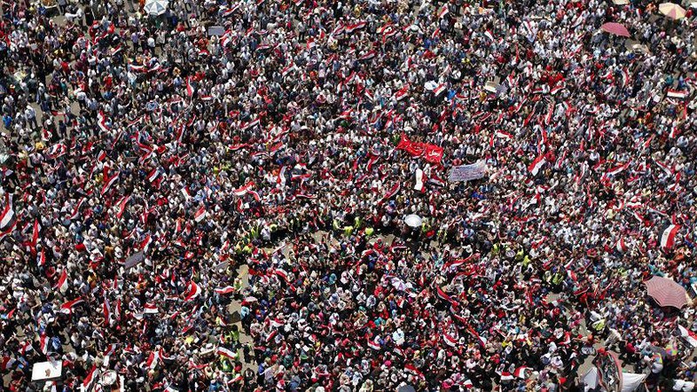 Protesters opposing Egyptian President Mursi shout slogans during a demonstration in Tahrir square in Cairo