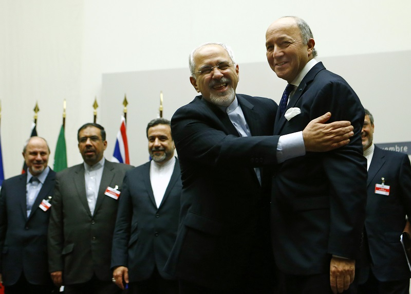 Iranian Foreign Minister Zarif hugs French Foreign Minister Fabius after a ceremony at the United Nations in Geneva