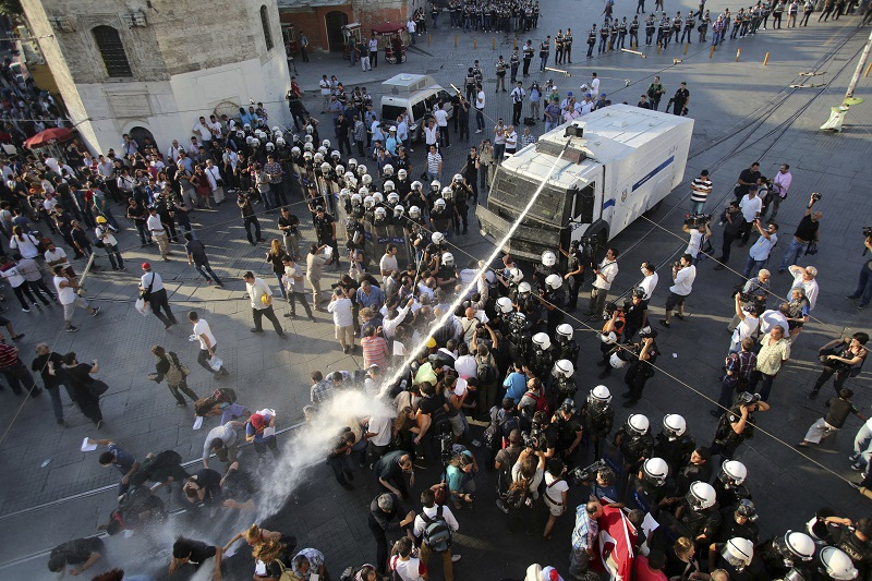 Riot police use a water cannon to disperse demonstrators during a protest at Taksim Square in central Istanbul